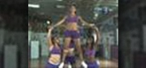 Do a thigh stand stunt in cheerleading