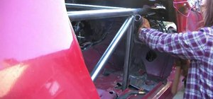 Fabricate and install passenger side bracing in a stock race car