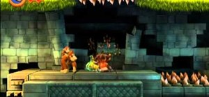 Get through the Barrel Blast level in Donkey Kong Country Returns