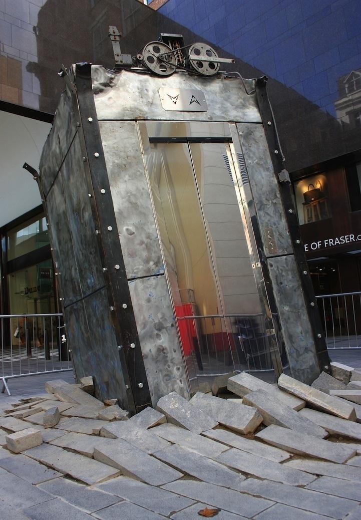 Steampunk Elevator Erupts from Underground