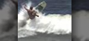 Perform an aerial on a surfboard