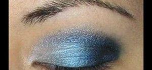 Apply silver and blue eyeshadow