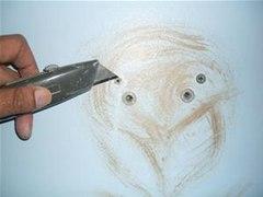 How to Mend Wall Holes Bigger Than Nails