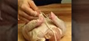 Truss a chicken for roasting with twine