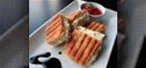 Make a grilled cheese sandwich with tomato, goat cheese and asiago