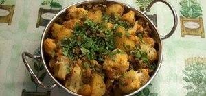 Make aloo gobi (spicy cauliflower and potato)