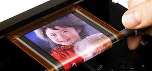 Wicked Cool Futuristic Roll-Up Screen (Thickness of a Human Hair!)