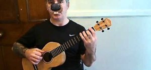 "Play ""Centerfold"" by the J. Geils Band on baritone ukulele"