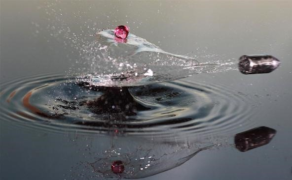 Speeding Bullet Vs. a Single Drop of Water
