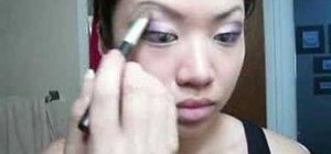 Apply a smoky purple eye makeup for Asian monolid eyes