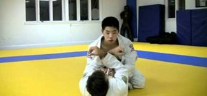 Perform a cross collar choke in Jiu-Jitsu