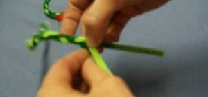 Make mini Christmas wreaths out of pipe cleaners