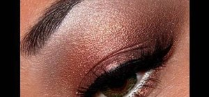 Apply copper, red, & gold eye makeup