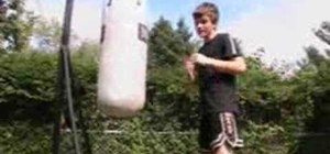 Hit a punching bag to prepare for a street fight