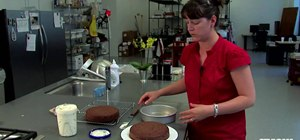 Frost the cake rather than your plate with an upturned cake pan