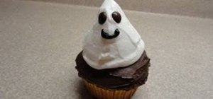 Decorate a cute ghost cupcake with an ice cream center for Halloween