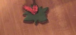Decorate poinsettia cookies with royal icing