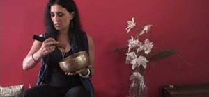 Play a Tibetan singing bowl