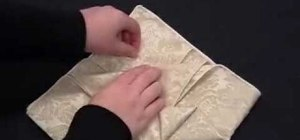 Fold an origami lily napkin design
