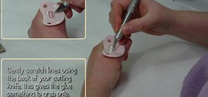 Glue a magnet onto a dummy/pacifier for a reborn doll