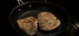 Make pan-seared tuna steaks over spinach
