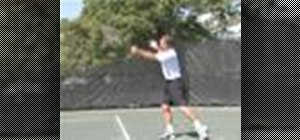Hit a forehand stroke in a game of tennis