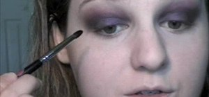 Apply a purple and gold makeup look