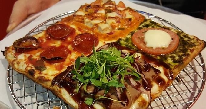Put Your Waffle Iron to Good Use by Creating a Pizza Waffle