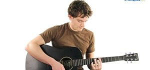 Play an A minor or Am chord on an electric or acoustic guitar