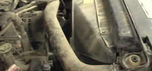 Replace the top coolant radiator hose in a Ford F-150