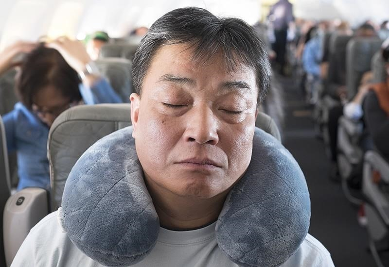 Sleep on Long Flights Like a Pro with These 13 Must-Know Tips