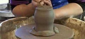 Turn a pot on the potter's wheel