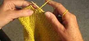 Unravel yarn by the stitch to fix a knitting mistake