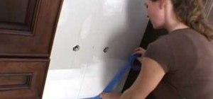 Install a glass tile backspash
