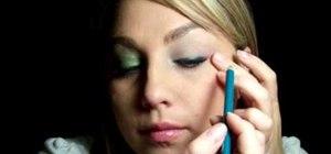 Apply dramatic green eyeshadow