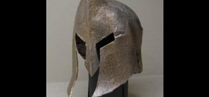 Make a Spartan war helmet out of cardboard and papier mache
