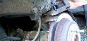 How to Lubricate the caliper pins or replace the brake pads on a