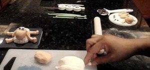 Make a fondant sheep for cake decorations