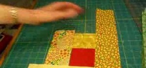Lay out and sew a log cabin quilt square
