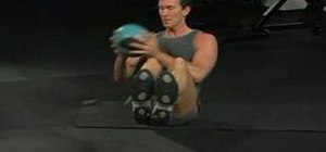 Do a seated V hold with twisting medicine ball bounce