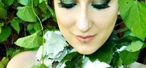 Create a deep emerald green leaves-inspired makeup look