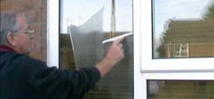 Wash your windows with a mop and squeegee like a pro