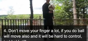 Spin a soccer ball on the end of your finger