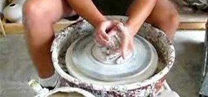 Center on the potter's wheel with clay