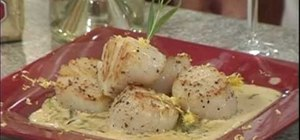 Cook seared scallops with asparagus and butter sauce