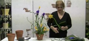 Make a spring arrangement using silk flowers