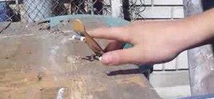 Half cab flip on a fingerboard