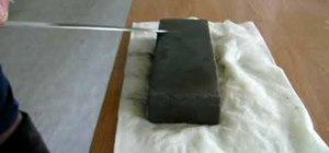 Sharpen a knife with a stone block