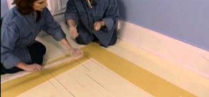 Measure, mark, and paint a diamond pattern on a hardwood floor