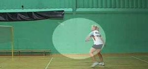 Defend with a backhand shot in badminton
